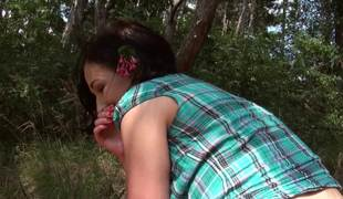 Outdoor sex session features a tremendous brunette teen on grass