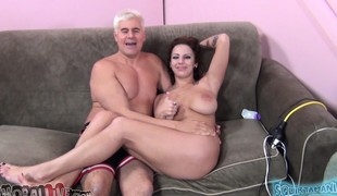 Huge breasted brunette Lylith Lavey deepthroats and fucks a big stick