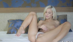 Teen sweetheart fingers and toys cunt in a solo act