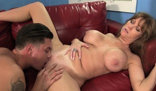 Breasty redheaded Darla enjoys taking a thick cum gun doggystyle
