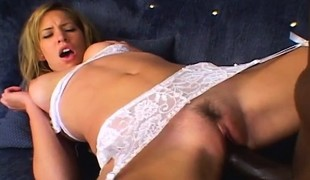 Sexy blond in white lingerie likes to impale herself on a black pole