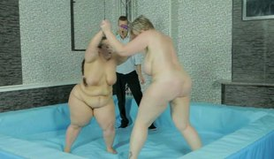 Obese wrestling babes build up a sweat and the winner gets fucked
