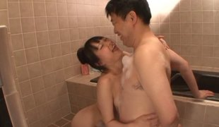 Soapy body rub from a Japanese girl makes him hard