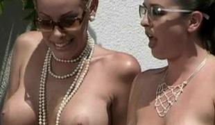 2 bosomy milfs play lesbian games in hardcore outdoor scene