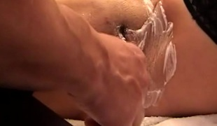 Shondra Serandon lets a guy shave her cunt and fuck it from behind