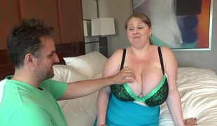 Horny dude sucking on and fondling the huge wobblers of a BBW