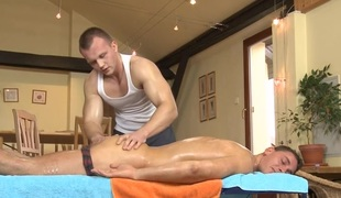 Cute twink receives a lusty massage from homo chap
