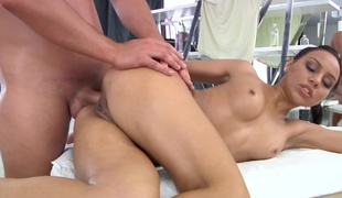 A hot woman is getting anally rammed on the massage table