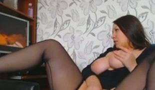 Damn hot and charming webcam brunette MILF in stockings fingered herself