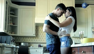 Husband fucks his busty wife Raylene in the kitchen