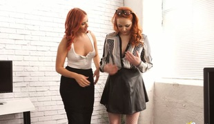 Two sexy redheads flesh their big boobies in front of each other