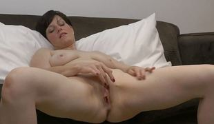 Milfs rubs her fleshy snatch