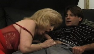 Luscious mature lady in nylons Kitty Fox has a passion for anal sex