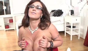 Eva Notty with giant hooters has some time to give some oral sex