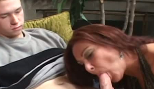 Lustful redhead granny giving head to excited juvenile guy