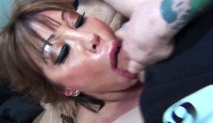 Sloppy cocksucking milf makes a mess of her face