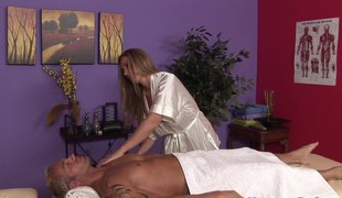 Lascivious blonde masseuse massaging and engulfing one very fortunate man