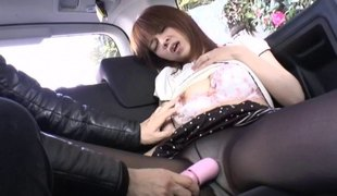 Asian cowgirl satisfied with nice toy in the car close up shoot