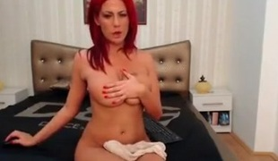Sexy stripteasing redhead babe seduces on webcam with her hot body