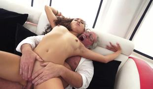 A curly long haired minx is feeling a grandpa inside her juicy slit