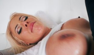 A large ass bimbo with a nice round ass is getting fucked really hard in her ass