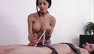 Scorching brunette jerks this hard penis
