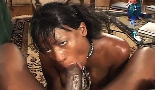 Curvaceous ebony woman in fishnet stockings orgasms on a dark shaft