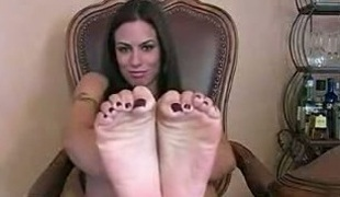 Dirty-minded dark haired playgirl brags of her sexy feet on webcam