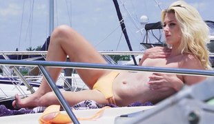 Slutty blonde in a bikini receives drilled on a rich man's boat