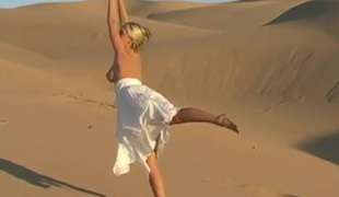 Bendy busty teen honey shows off natural assets on sand dunes