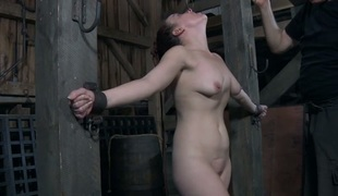 Bounded slave beauty is getting a lusty snatch torture