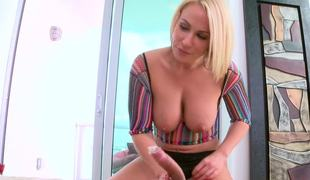 Curvy blonde pornstar with a fine booty rides a terrific meat pole