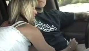 Lustful blonde MILF stroking uncle's dick during the time that he's driving