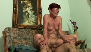 A nasty old woman gets a young cock in her meaty pussy