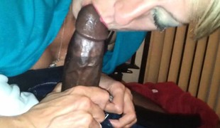 Lascivious grandma eating a large black cock.