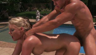 Tanned bitch with great rack gets drilled under the sun