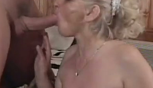 Naughty blonde granny in red stockings screwed bad missionary style