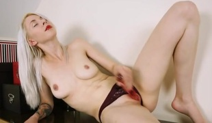 British lipstick angel rubbing a toy along her cunt