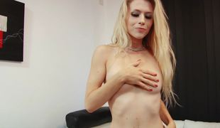 A blonde removes her clothes and then she sucks a big dildo