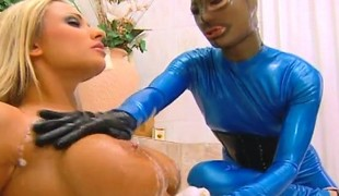 Breasty blonde Brianna Banks gets a masked stud banging one as well as the other fuck holes