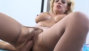 Nasty blond milf with large hooters receives pumped full of young meat