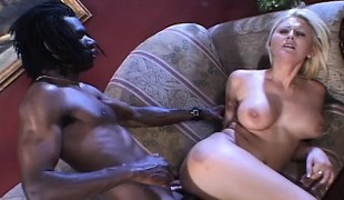 Lustful Staci Thorn chews on a large black stick and gets ass fucked