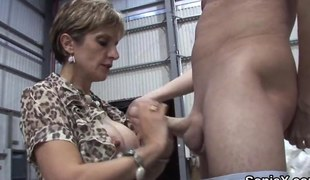 Sexy English milf sucking large shaved rod in a close up