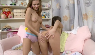 Into the wet teen twat goes a pink dong cock worn by a lesbo