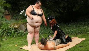 Mistress and her SSBBW ally fuck a submissive slave stud outdoors