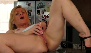 Mamma on her kitchen counter masturbates passionately