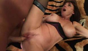 Busty mature slut Karen Kougar in black nylons gets her massive tits rubbed and her pink cunt fucked at the same time. Her fuck buddy drills her many times sued vagina nice and hard
