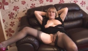 Attractive granny in hose tease