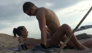 Dasi West and fellow make love in the empty beach without shame